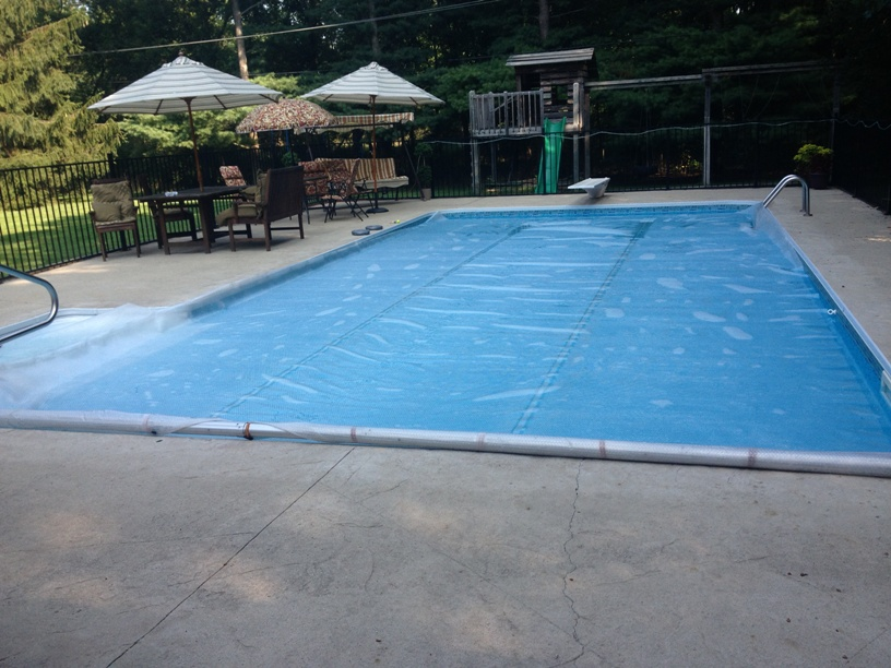 Q A I Keep Hearing About Pool Covers And Their Benefits