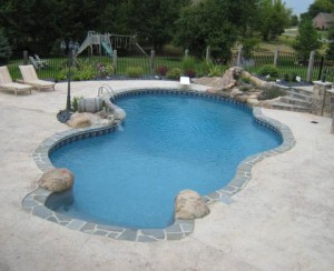 Vinyl Liner Pool with hancarved Waterfall and themed privacy fence, wine barrell water feature and chlorine generating salt system in Saline MI by Legendary Escapes Pools (12)