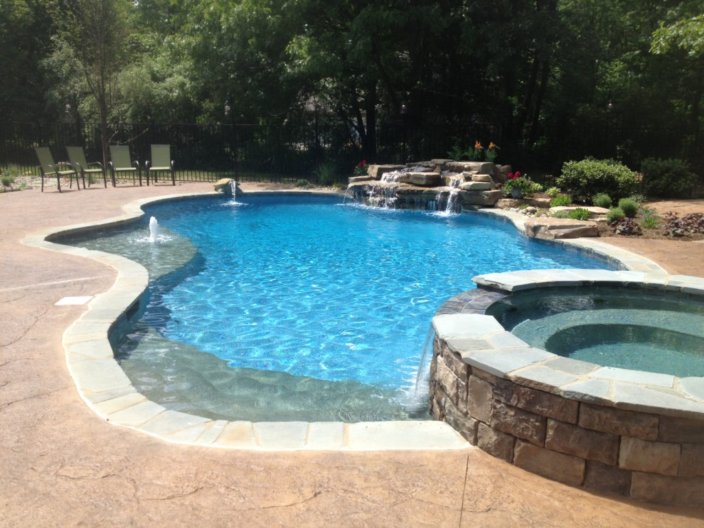 9 popular pool surfaces for gunite concrete fiberglass for Vinyl swimming pool